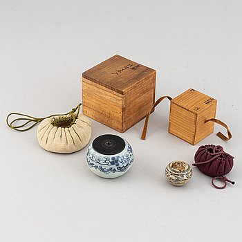A group of two blue and white jars, one Korean, 19th century, the other Sawankalok, 13-14th century.