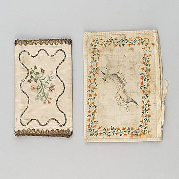 Two silk wallets, one painted and one embroidered and dated 1785.