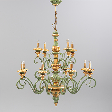 A painted and bronzed chandelier in wood and metal, from the second half of the 20th century.