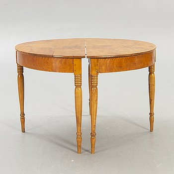 A mid 1800s birch dining table.