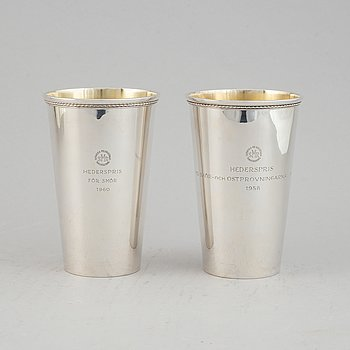 A pair of swedish parcel-gilt silver beakers, GAB Stockholm 1957 and 1960.