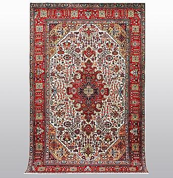 A carpet, Tabriz 310 x 200 cm.