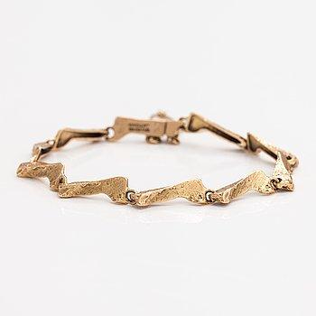 "Björn Weckström, A 14K gold bracelet ""Stream"". Lapponia 1975."