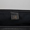 Dunhill, a black leather weekend bag.