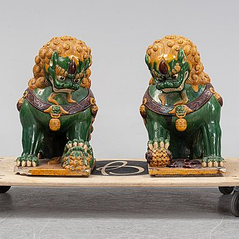 A pair of sancai-glazed chinese buddhist lions or guardian lions, early 20th century.