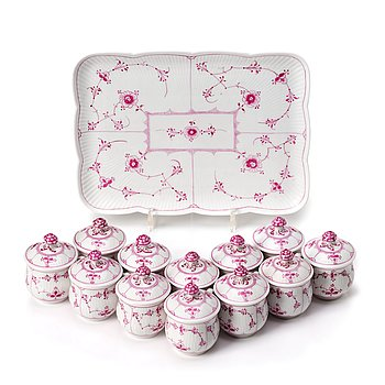 343. A set of 12 Royal Copenhagen Ruby Red Musselmaalet custard cups with a tray, Denmark, circa 1900-1923.