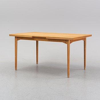 An oak dining table, 1960's.