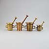 A set of four brass mortars and pestles, 18th and 19th century.