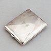 A silver travel alarm clock, makr of hasset & harper ltd, birmingham 1921.