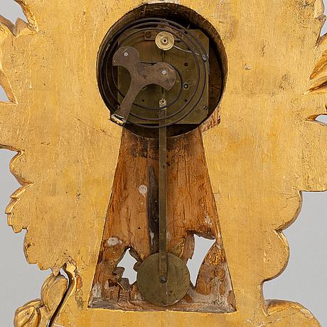 A rococo style table clock, 19th century.