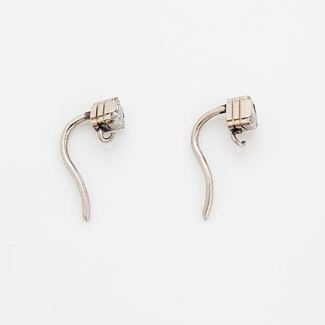 Triangle shaped diamond earrings.