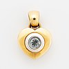 18k gold and blue stone heart pendant.