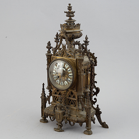 A mantle clock with pair of candelabra, late 19th century.