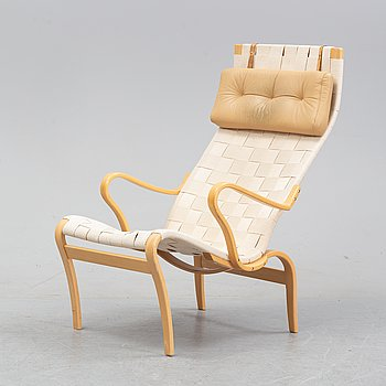 A 'Miranda' easy chair by Bruno Mathsson dated 1995.