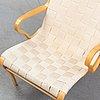 A 'miranda' easy chair by bruno mathsson dated 1995.