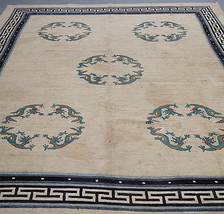 A carpet, semi-antique/old tibet, ca 365 x 281 cm.