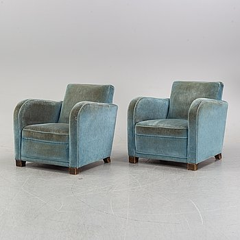 A pair of 1930s armchairs in sea foam green plush.