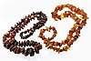 4 amber necklaces, amber brooch and pendant, metal, lengths approx 65-90 cm.