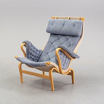 "A ""Pernilla"" lazy chair by Bruno Mathsson for Dux."