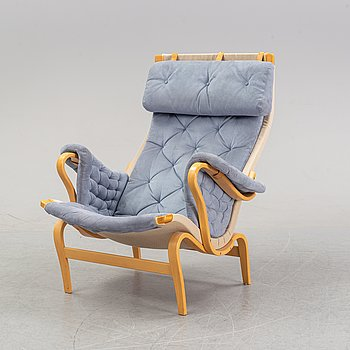 "A ""Pernilla"" lazy chair by Bruno Mathsson for Dux."