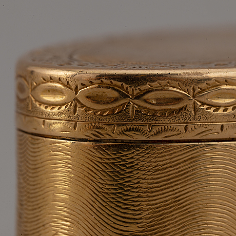 A gold box and four silver boxes, 19th-20th century.