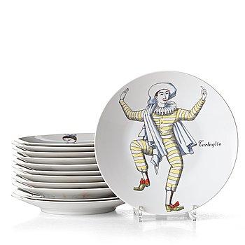 """FPORNASETTI, a set of 12 """"Maschere Italiane"""" porcelain plates, Milan, Italy."""