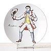 """Piero fornasetti, a set of 12 """"maschere italiane"""" porcelain plates, milan, italy."""