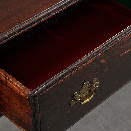 An english oak sideboard with three drawers, late 19th century.
