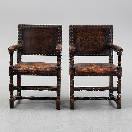 A pair of baroque style armchairs, first half of the 20th century.