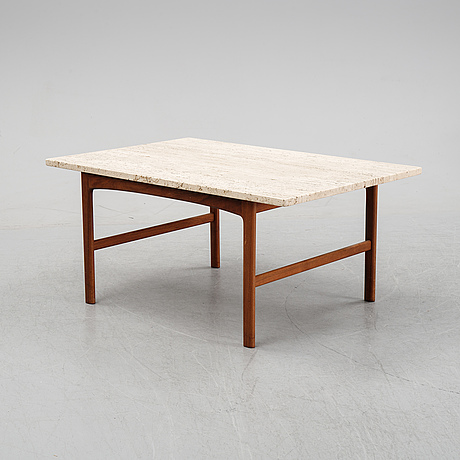 A 1960's walnut and travertine coffee table.
