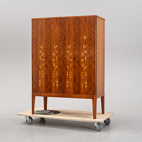 A 1940's swedish modern mahogany cabinet from möbelbolaget.