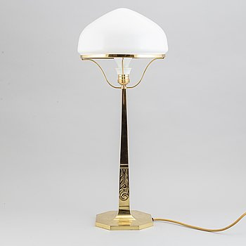An Art Nouveau brass table lamp, early 20th century.