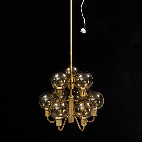 Hans-agne jakobsson, a late 20th century brass and glass ceiling lamp for nine lights, markaryd, sweden.