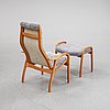 "Yngve ekström, a lounge chair with ottoman ""lamini"", swedese möbler ab, sweden. 2006."