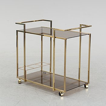 A brass and glass drink trolley, end of the 20th Century.