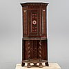 A painted corner cabinet, dated 1778.