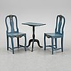 A pair of painted chairs and a table, 19th century.