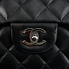 Chanel, a black, quilted leather 'jumbo single flap bag'.