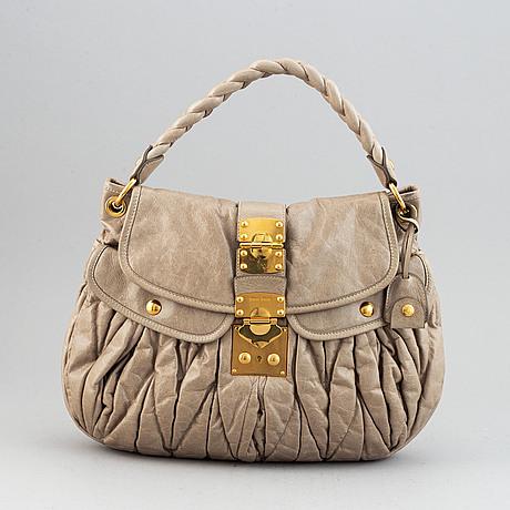Miu miu, a light leather handbag.