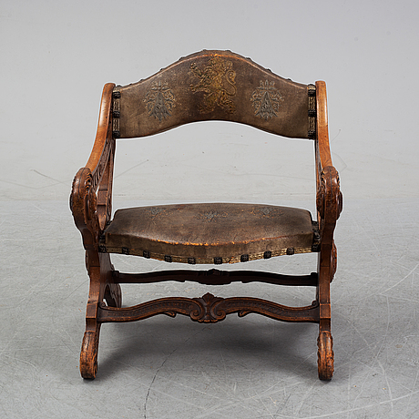 A renaissance style armchair, around the year 1900.
