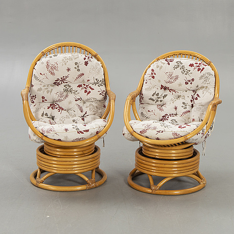 A pair of bamboo and rattan swivel chairs later part of the 20th century.