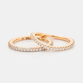 """Ole Lynggaard two rings """"Love"""" in 18K gold set with round brilliant-cut diamonds."""