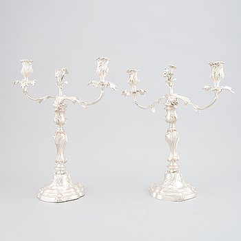 A pair of silver plated rococo-style candelabras, 19th century.