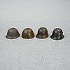 Four steel helmets.