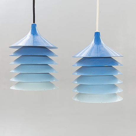 """A pair of ikea """"duett"""" 1970s ceiling lamps."""