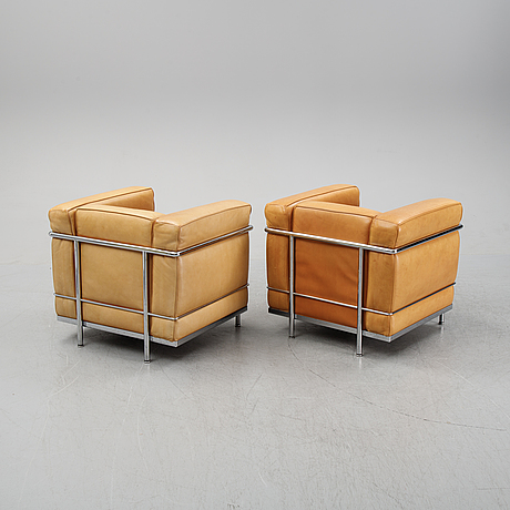 Le corbusier, pierre jeanneret, charlotte perriand, a pair of leather and tubular steel 'lc2' lounge chairs, cassina.