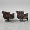 A pair of  battaglia easy chairs, 2015.