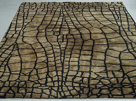 "A carpet, ""nabucco - noir"" tufted, designers guild, ca 291 x 200 cm."