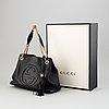 Gucci, a black leather 'soho' bag.