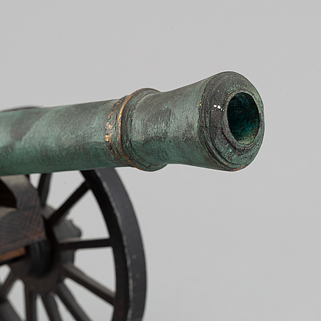 A copy of a field canon with monogram of king  karl xii produced by svensk metallkonst, carlscrona in late 20th century.